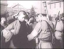 Japanese troops intensively searched for stragglers and plain-clothes soldiers. A scene from the film Nanking.