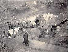 Refugee huts outside Nanking. March 1938.