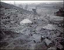 Refugee huts at Tse Hsia Shan, outside Nanking. March 1938.