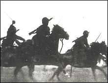 Japanese troops marching toward Nanking.