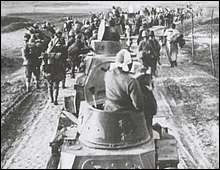 Japanese troops entering the suburbs of Nanking.