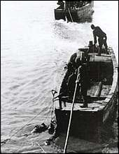 Japanese troops throwing bodies into the Yangtze River. Photo taken by Murase.