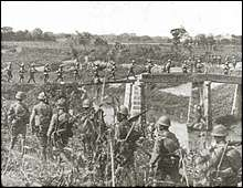 Japanese troops marching about 12 miles (20 km) north of Shanghai.