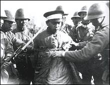 A Chinese soldier captured by Japanese troops.