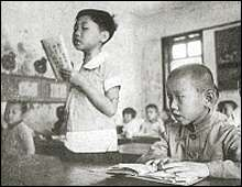 An elementary school in Nanking. Chinese children receiving pro-Japanese education. Photo used by P. R. Dept. of the China Expeditionary Force of Japan.