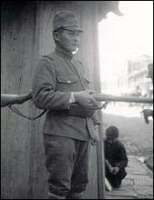 A Japanese soldier on sentry duty. March 1938.