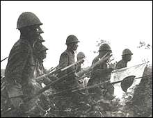 Japanese troops marching toward Nanking. Photo used by P. R. Dept. of the China Expeditionary Force of Japan.